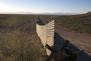 A border wall a few miles from the U.S.-Mexico border near Agua Prieta, Mexico, and Douglas, Ariz.  (Cronkite News Service Photo / Courtney Sargent)